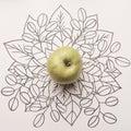 Green apple over outline floral background