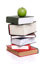 Green apple over stack of books Royalty Free Stock Images