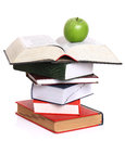 Green apple over stack of books Royalty Free Stock Image