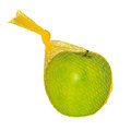 Green apple packed in a yellow mesh Stock Photo
