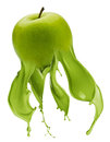 Green apple with paint splash Royalty Free Stock Photo