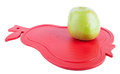 Green apple on the red pear cutting board look like Royalty Free Stock Photos