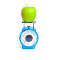 Green apple on scale weight control concept Stock Photo
