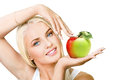 Green apple smiling beautiful woman holding in hands red Stock Images