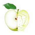 Green apple splash photo of with leaf slice and isolated on white Royalty Free Stock Image