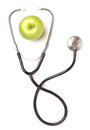 Green apple and stethoscope isolated on white background Stock Image