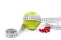 Green apple and vitamins for healthy diet a with measurement tape Royalty Free Stock Photography