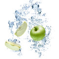 Green apple in water under with a trail of transparent bubbles Royalty Free Stock Photo