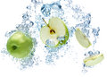 Green apple in water under with a trail of transparent bubbles Stock Image