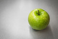Green apple with waterdrops Royalty Free Stock Photo
