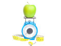 Green apple weight concept fresh on a scale with a centimeter isolated Stock Photo