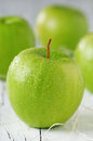 Green apple on the wooden table selective focus Stock Image