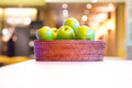 Green apples in the basket Stock Photos