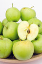 Green apples in a bowl close up Royalty Free Stock Images