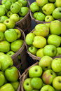Green Apples In Bushels Royalty Free Stock Image