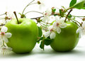 Green apples and flowers Stock Photo