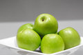 Green apples in a plate granny smith white close up Stock Image
