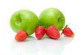 Green apples and ripe strawberrie Stock Photography