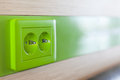 Green appliance receptacle for charging close up Stock Image