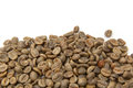 Green arabica coffee beans isolated on a white background with copy space Royalty Free Stock Photos