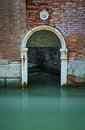 Green arched doorway on a canal in venice italy Royalty Free Stock Photography