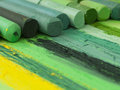 Green artistic crayons in the row creating colorul image Stock Photos