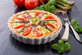 Green asparagi Tart with eggs and tomato Royalty Free Stock Photo