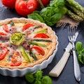 Green asparagi tart with eggs and tomato a Stock Photos