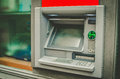 Green atm in filter with window Royalty Free Stock Photos