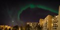 Green aurora borealis over city buildings see my other works in portfolio Stock Photography