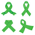 Green awareness ribbons on a white background