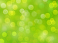 Green background with bokeh defocused lights Royalty Free Stock Photo