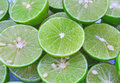 Green background with citrus fruit of lime slices lemons was cut out in order to squeeze out the water Royalty Free Stock Photography
