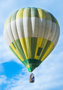 Green balloon on blue sky Royalty Free Stock Photos