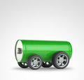 Green battery with car wheels Stock Photos