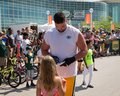 Green Bay Packer Player Signing Autograph for Young Fan Royalty Free Stock Photo