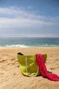Green beach bag on the seacoast and pink shawl Royalty Free Stock Photo