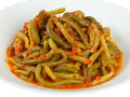 Green bean with tomato sauce cooked on white background Royalty Free Stock Photo