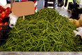 Green beans for sale on market a heap of fresh long healthy an italian Royalty Free Stock Images
