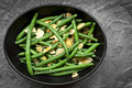 Green Beans with Toasted Almonds in Black Bowl Royalty Free Stock Photo