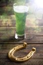 Green beer and horseshoe Royalty Free Stock Photo