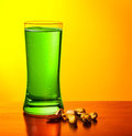 Green beer and nuts Stock Photography
