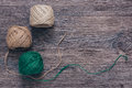 Green and beige tangles of thread on a wooden surface. Linen yarn.