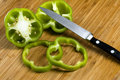 Green bell pepper and knife Royalty Free Stock Photography