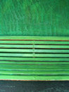 Green bench on a green wall Stock Photo