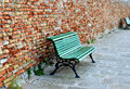 Green bench and old rustic wall Royalty Free Stock Photo