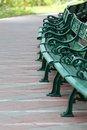 Green benches in the public park equipment furniture of decorate Royalty Free Stock Photo