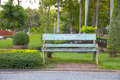 Green benches beside walkway in the park Royalty Free Stock Photo