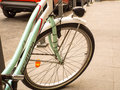 Green bike on sidewalk Royalty Free Stock Photography