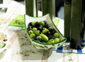 Green and black olives in porcelain plate on a table Royalty Free Stock Photo